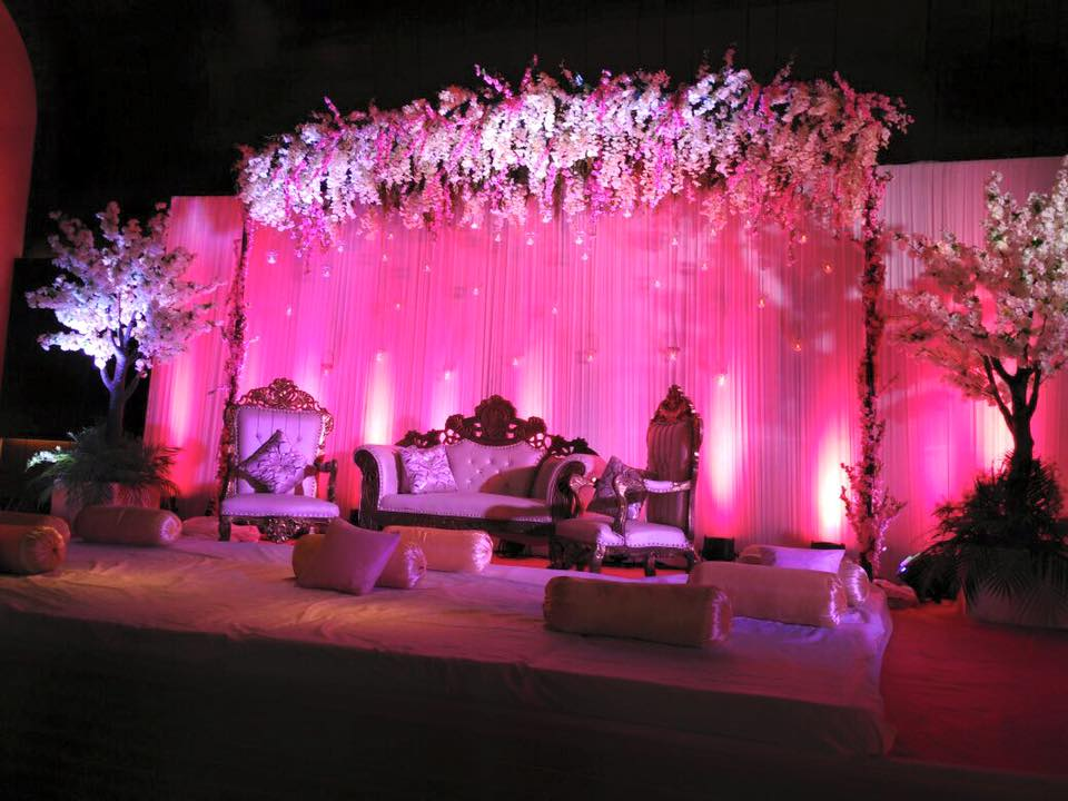 white and pink floral reception stage decoration ideas