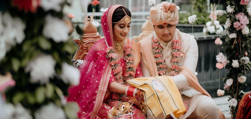 couple in traditional outfits at their wedding