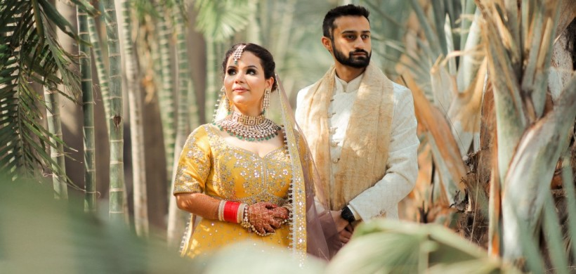 Punjabi couple in coordinated yellow outfits