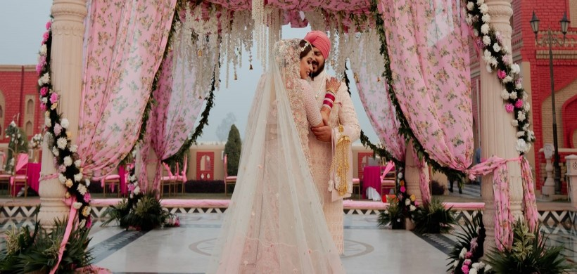 Punjabi couple in coordinated pink outfits
