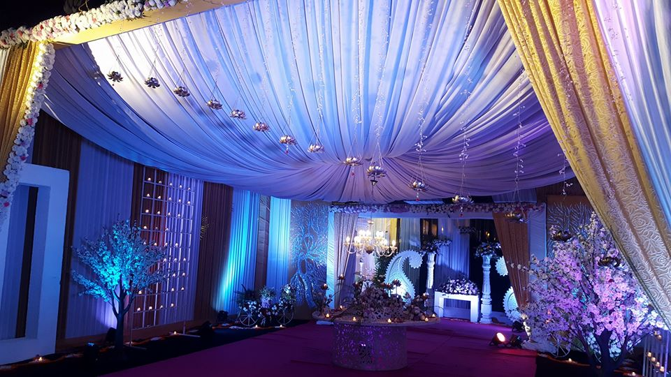 white drapping wedding entrance gate decoration