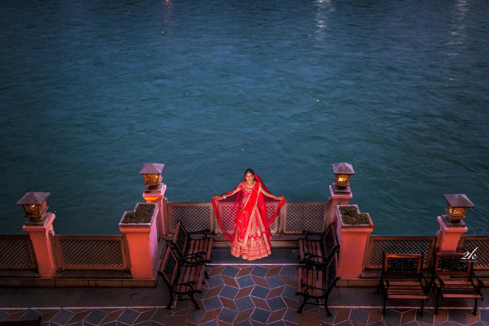 bride pose near a lake