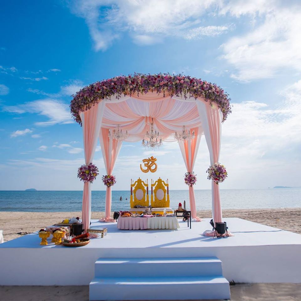 pink and white  mandap in  beach wedding
