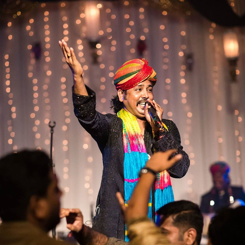 colorful singer at wedding sangeet