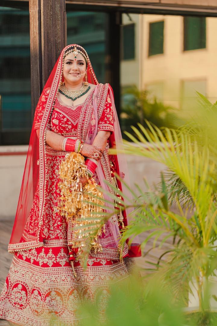 gorgeous bride in red lehenga