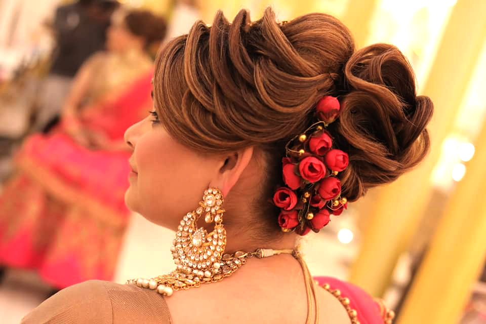 Beautiful bridal hairstyle with floral bun