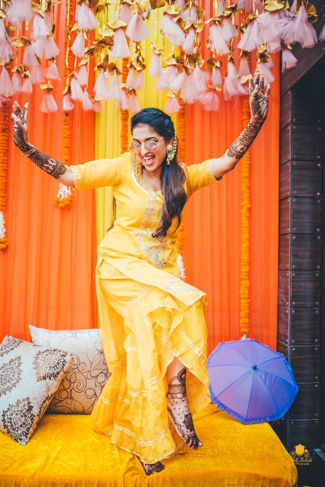 Dancing Bride in Her Mehendi Ceremony
