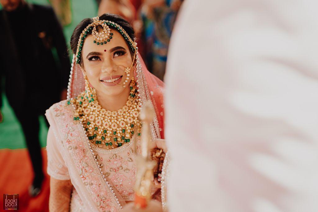 bride in pastel lehnga