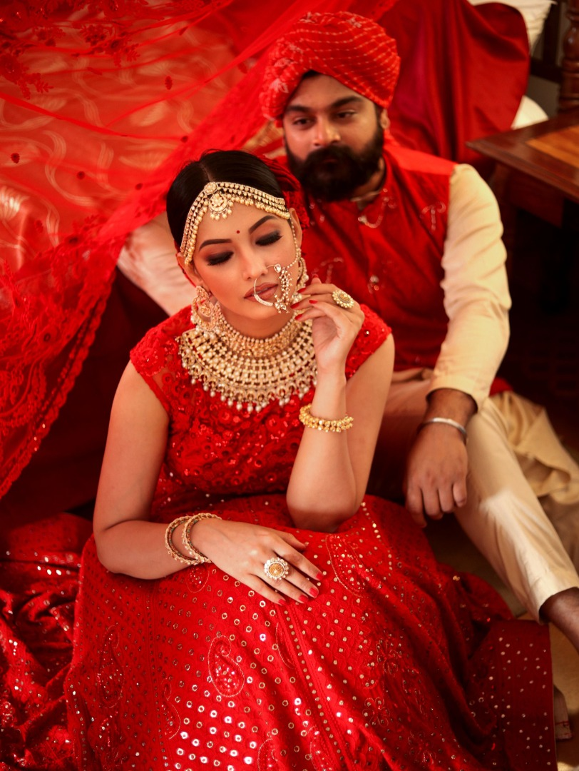 couple in red pose together