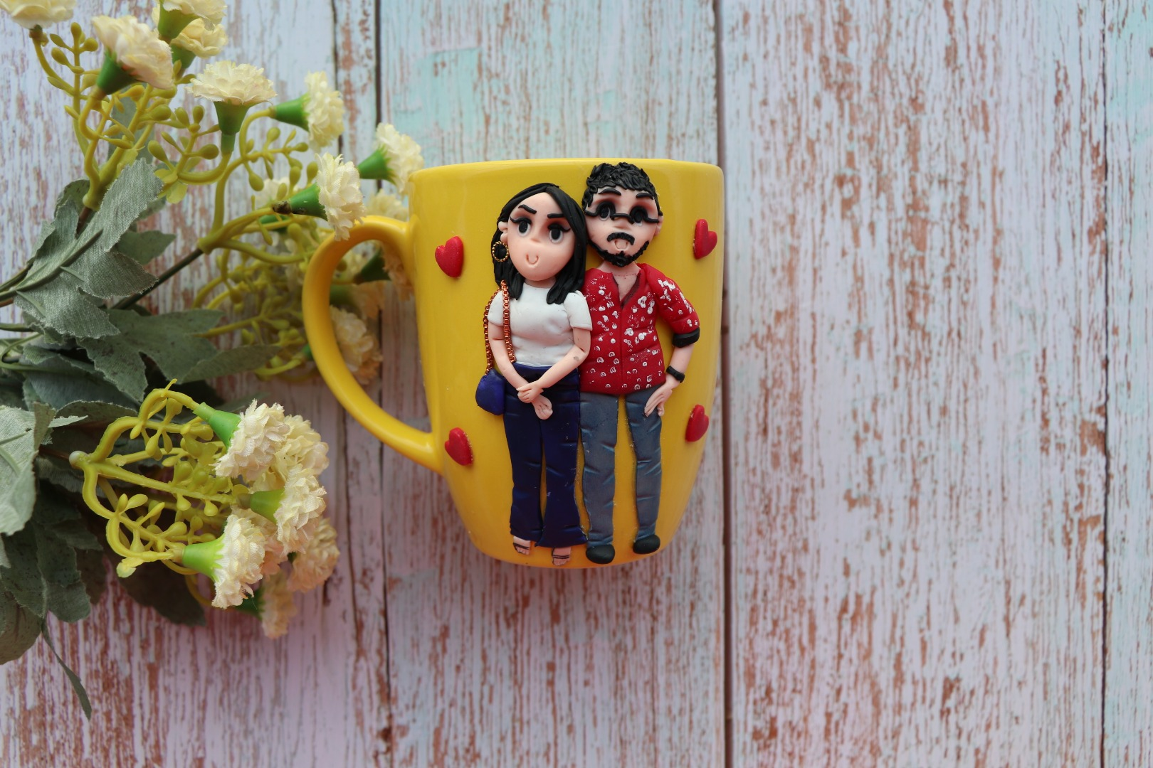 cute mug with the couple's caricature