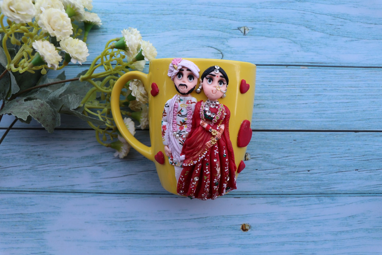 cute coffee mug with couple's caricature in traditional attire