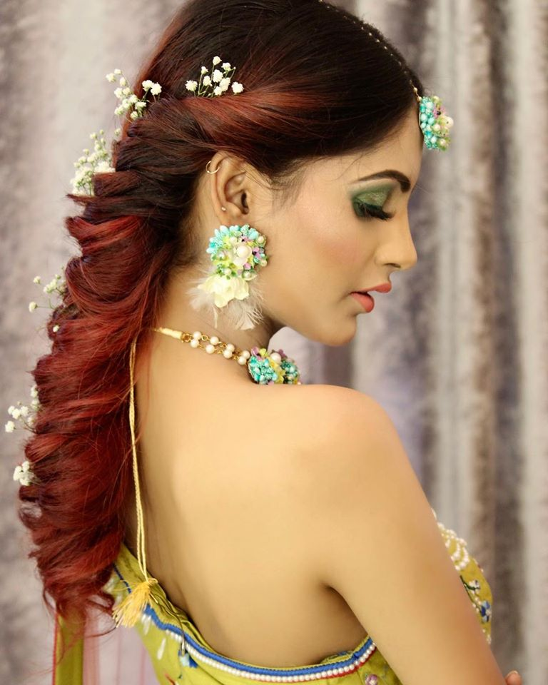 Mehendi Ceremony Natural Makeup Look with Green Smokey Eye & Colorful Floral Jewellery and a Fish Tale Hairstyle with Baby Breath Flowers