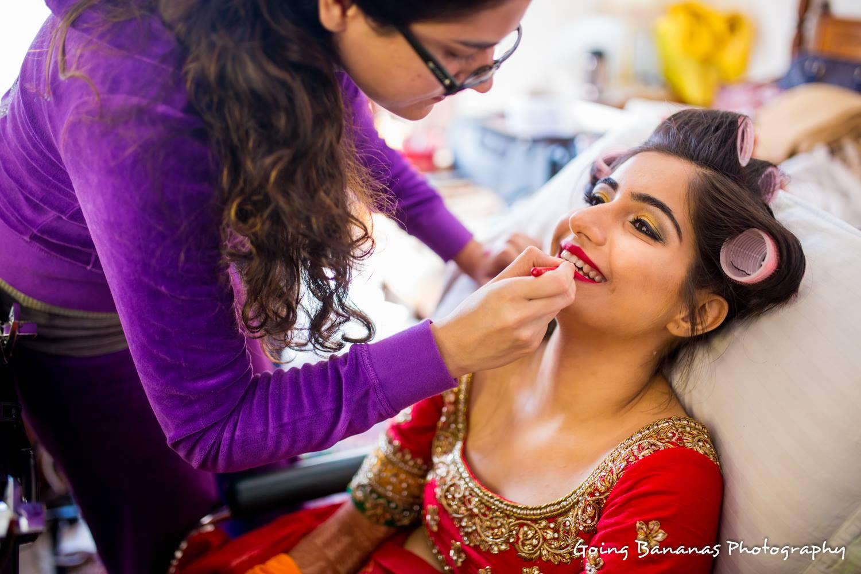 Bride getting hair curls