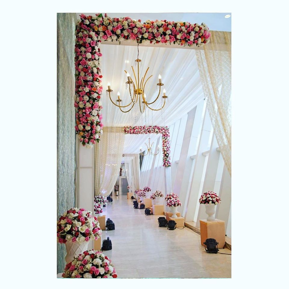 Floral Entrance Decor with White Drapes and Chandelier