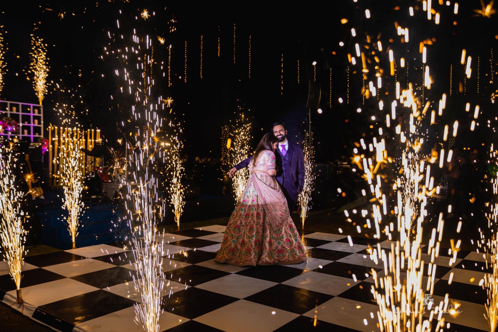 couple dancing in between fireworks