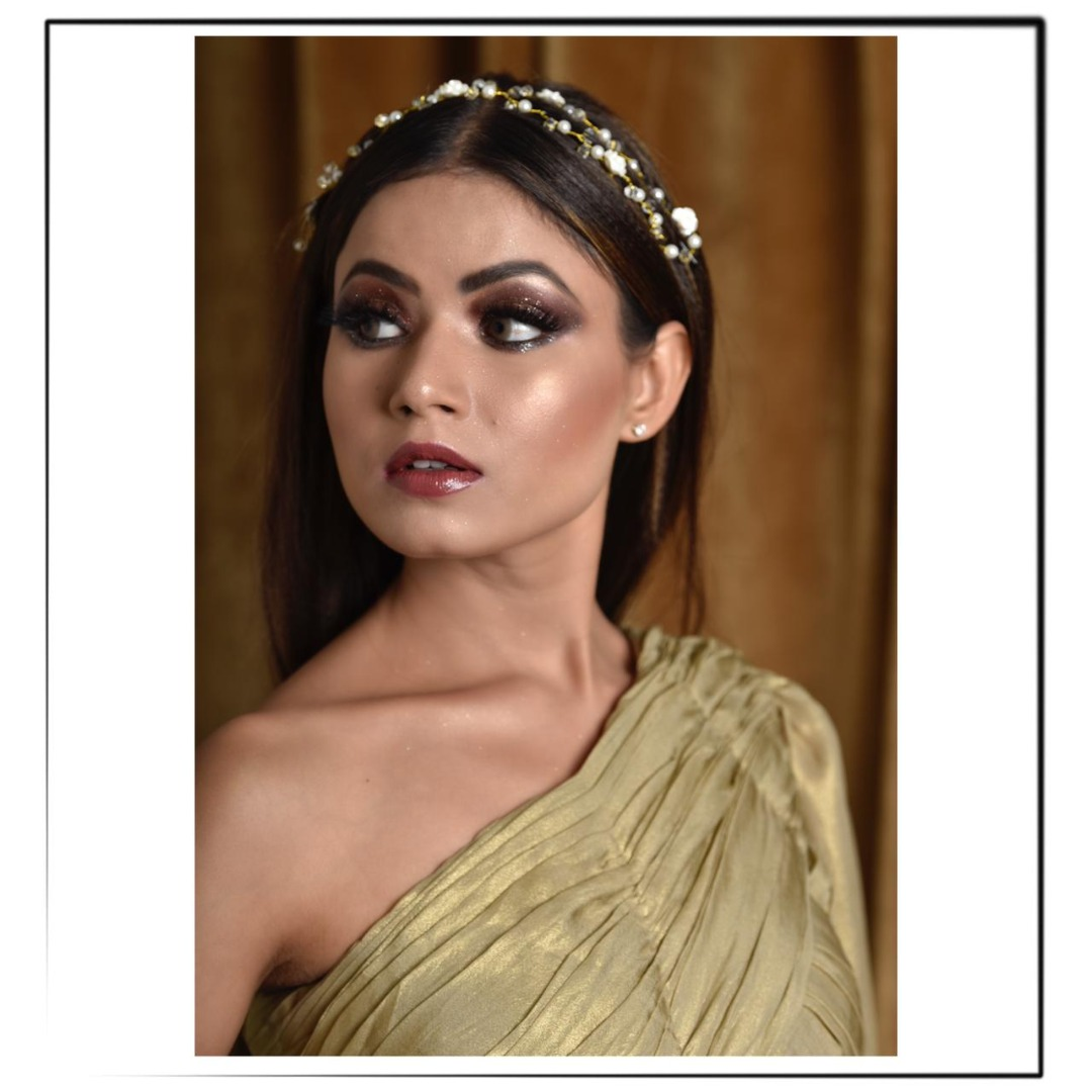 bride in one shoulder gown with stunning makeup