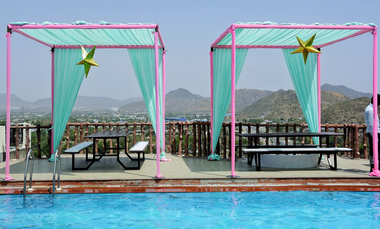 poolside decorated in pastel green and pink