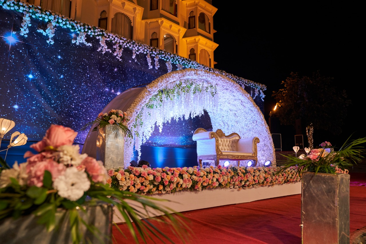 stage decorated with stunning floral arrangements