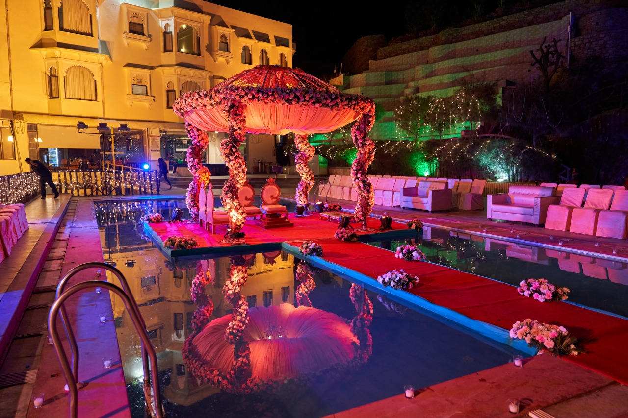 floating mandap decorated with lights and flowers