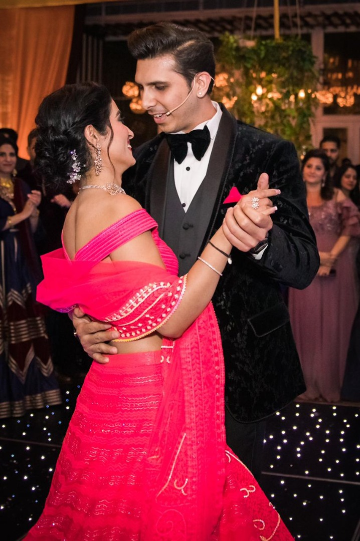 couple in contrasting outfits dancing together
