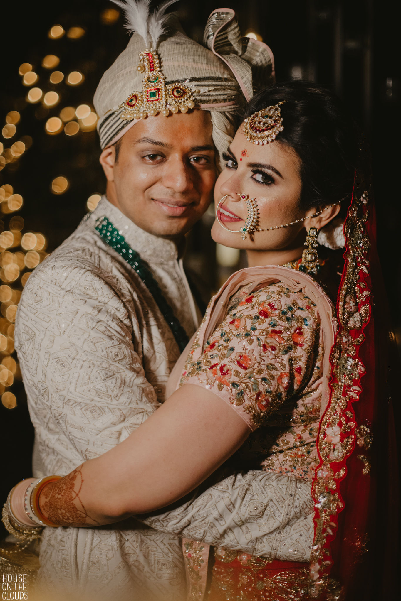 Bride and groom poses for indian wedding