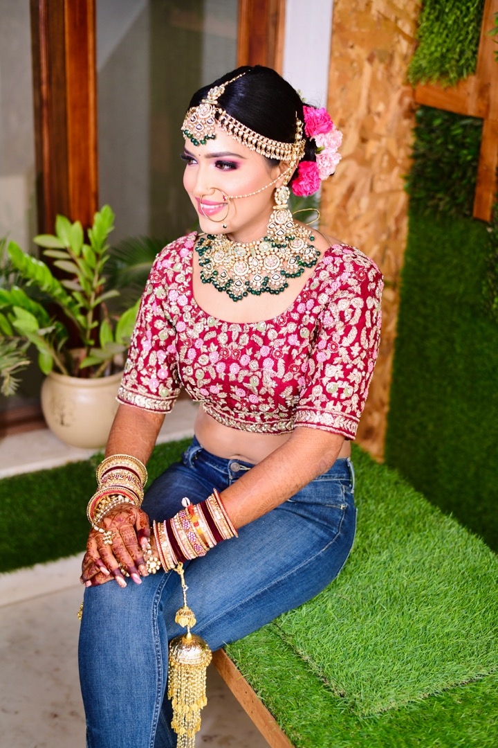 bride poses in jeans