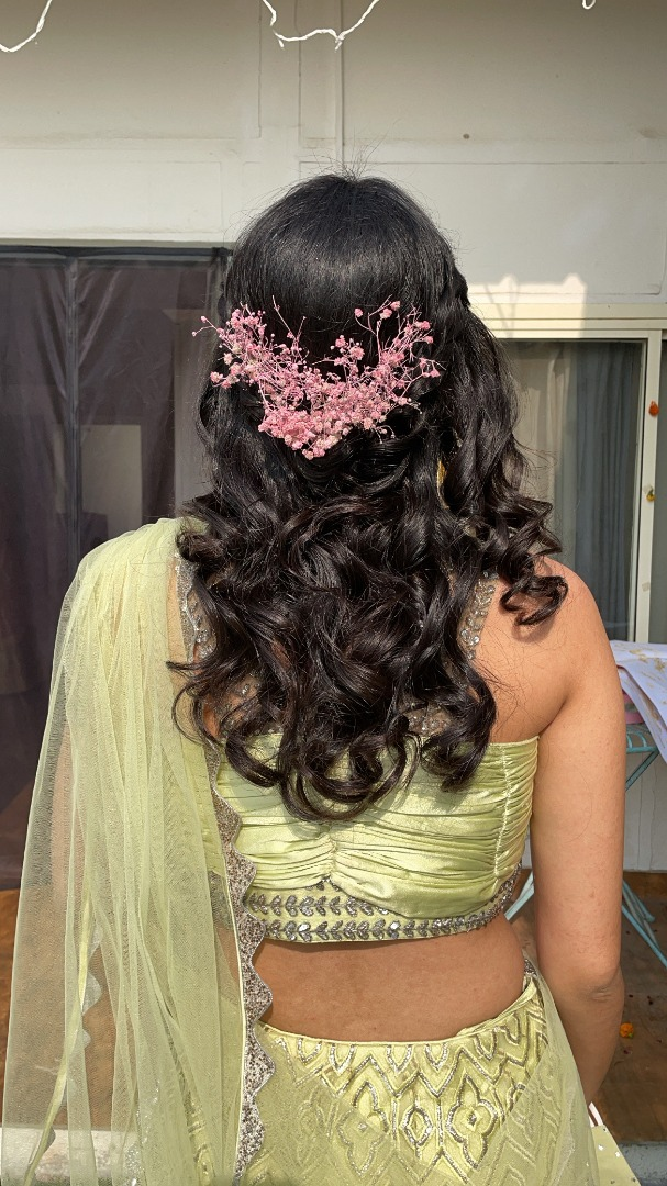 wavy hairstyle with floral details