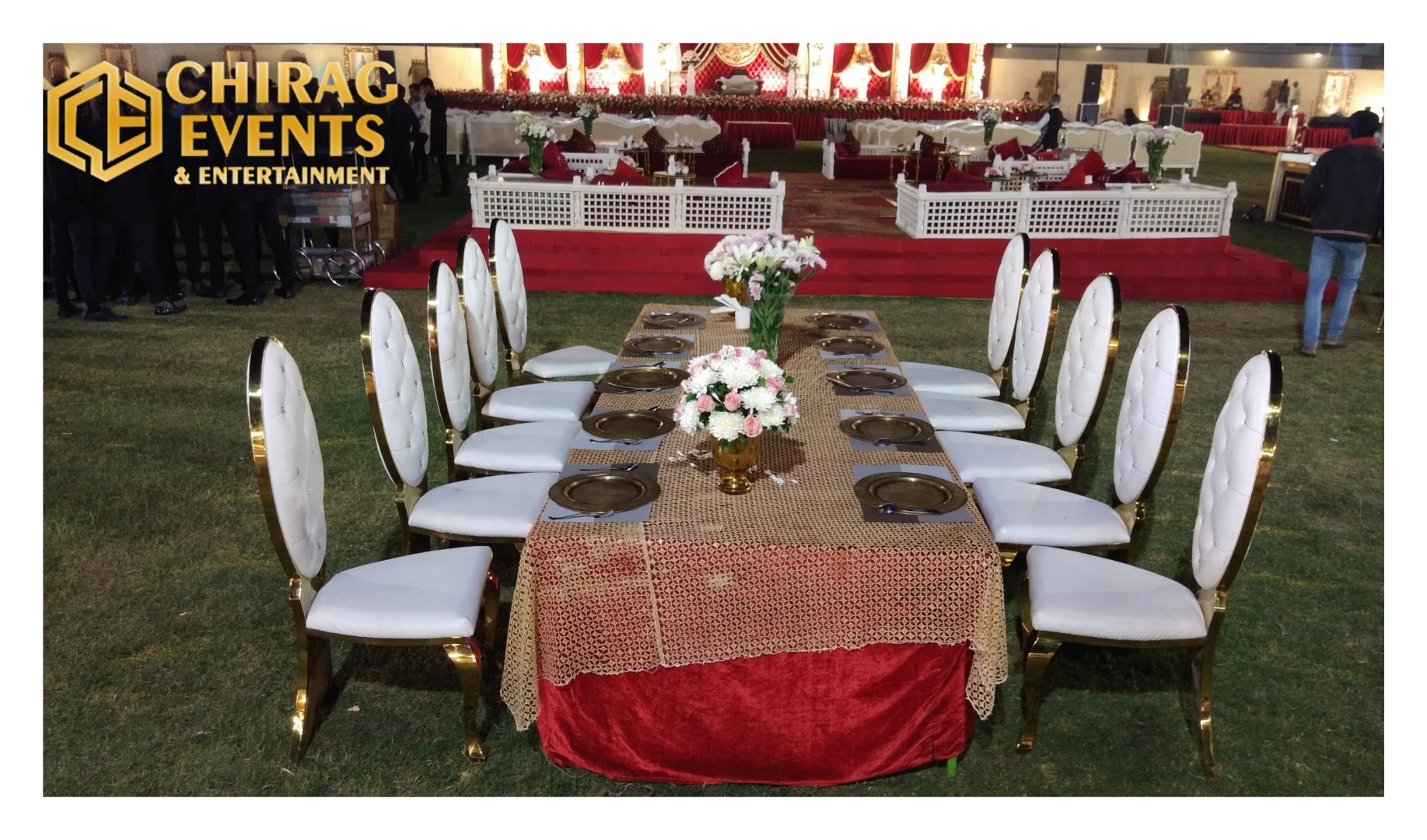 couple table with white chairs decorated with flowers