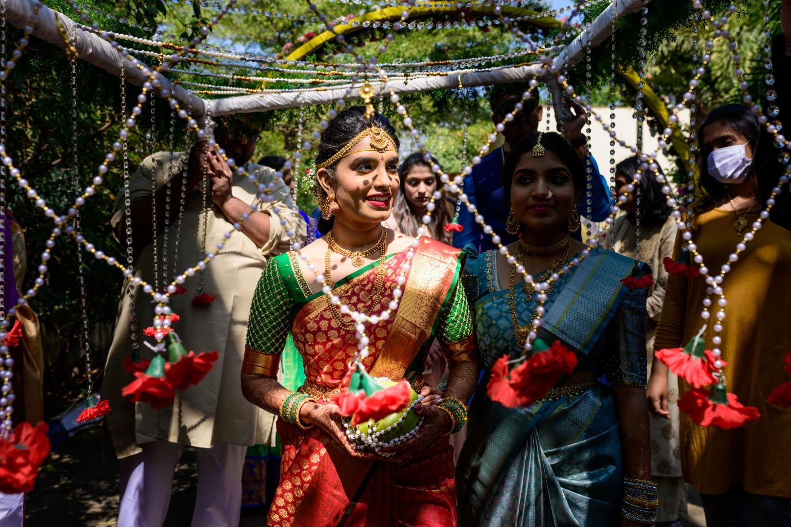 bride enters under a floral net