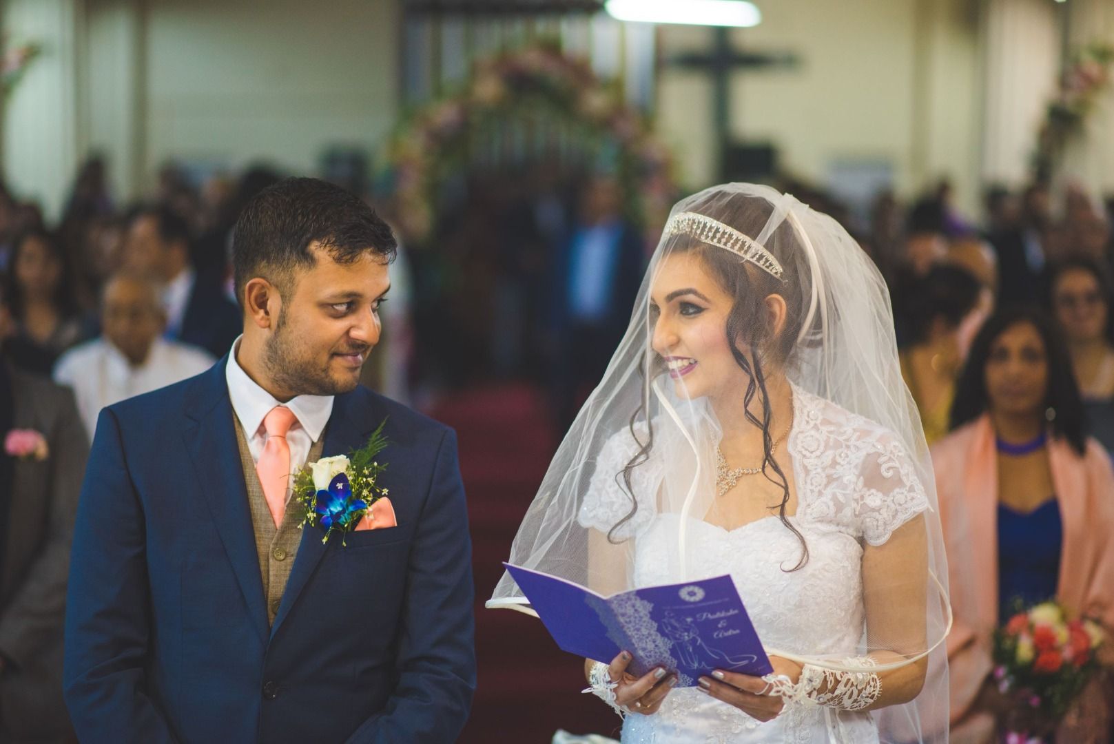 Christian bride in white and groom in blue suit