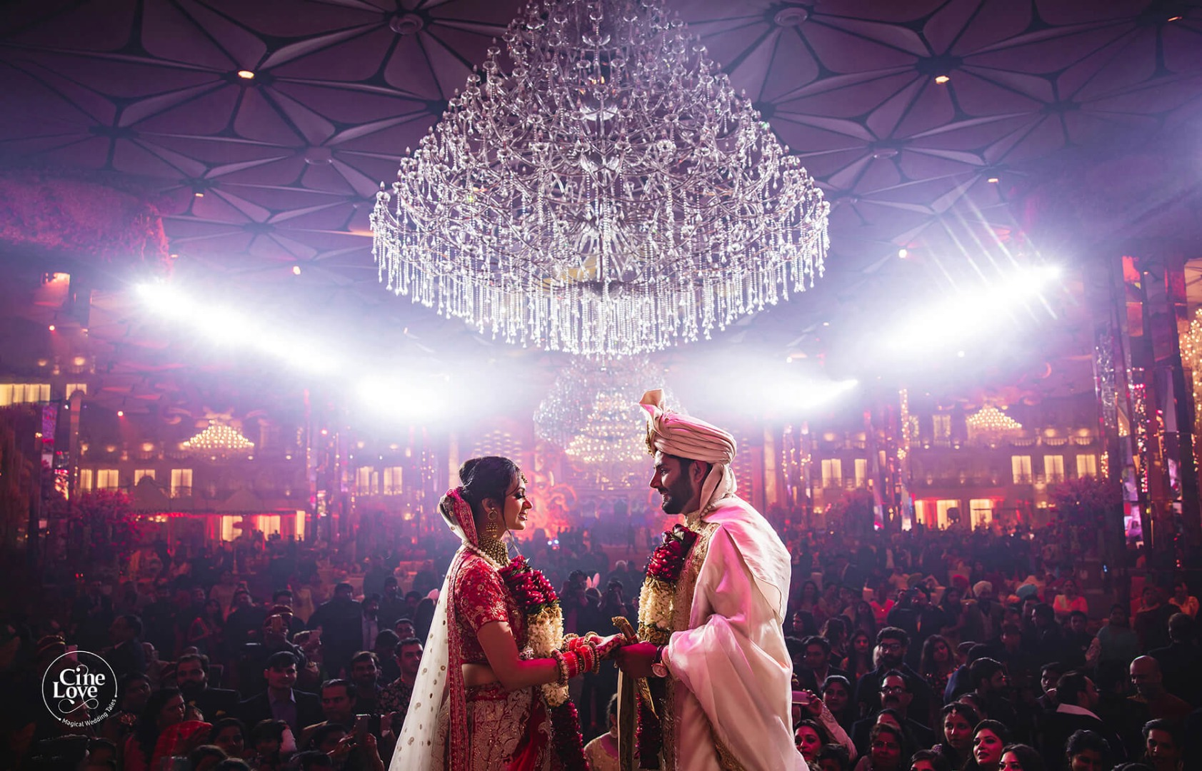 Bride & Groom Hand in Hand on Wedding Stage