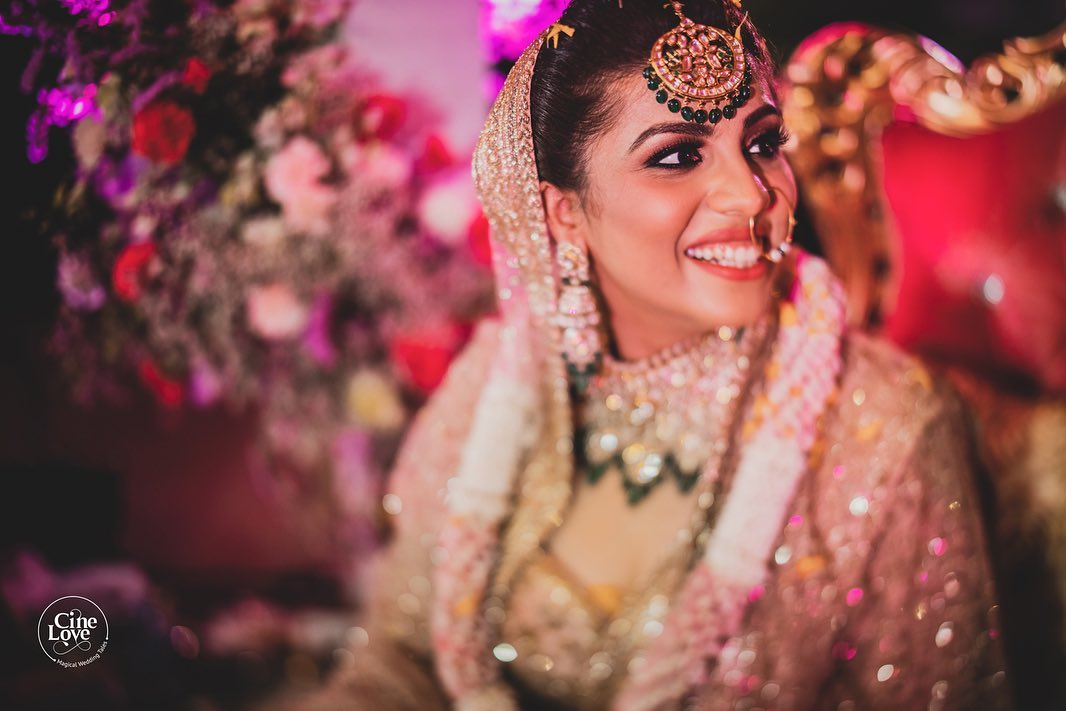 A Smiling Bride in Gold Outfit Solo Picture