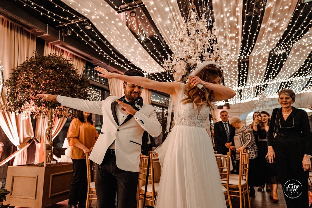 Bride & Groom Dab in a White Theme Christian Wedding