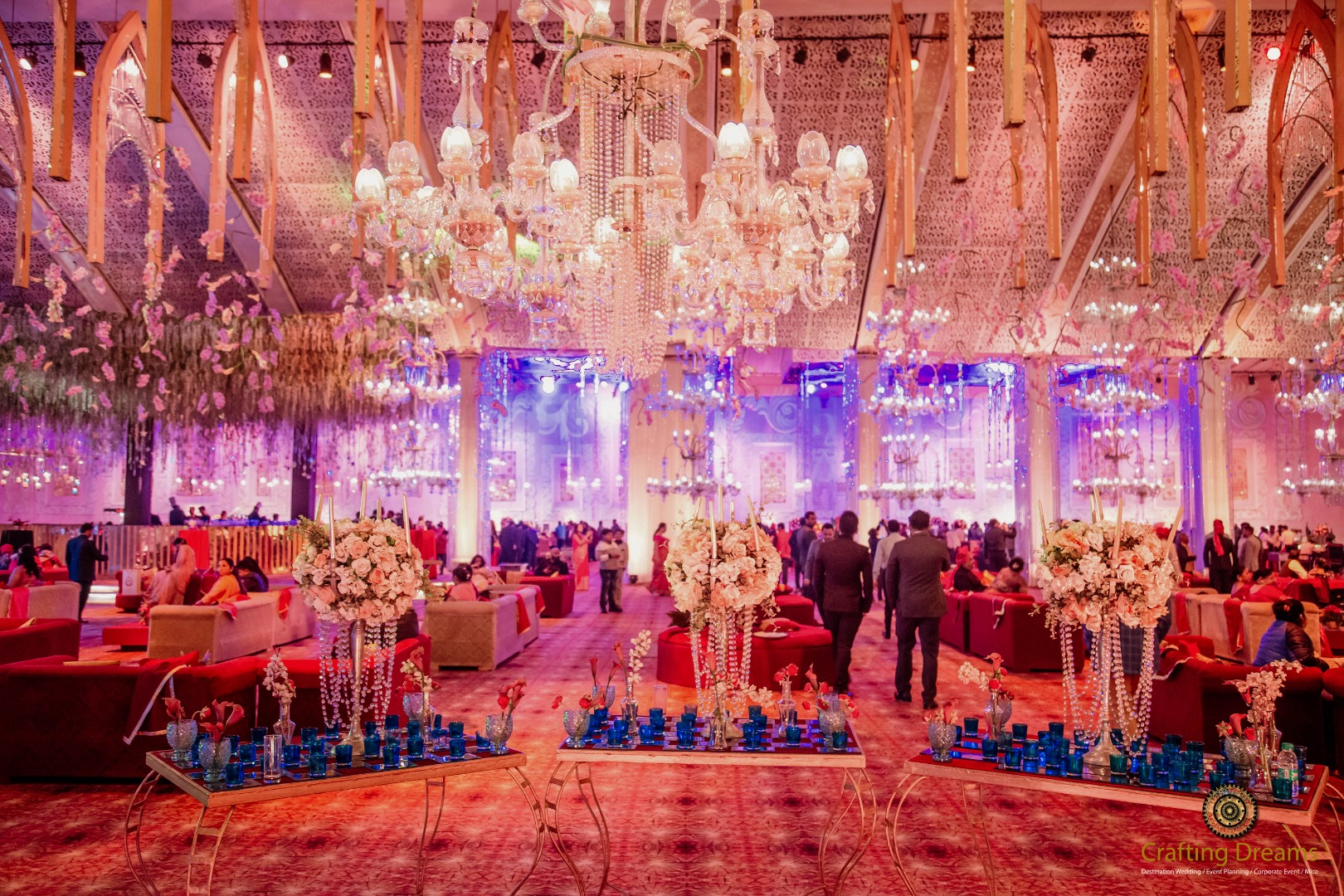 Grand Indoor Wedding Decoration with crystals and chandeliers.