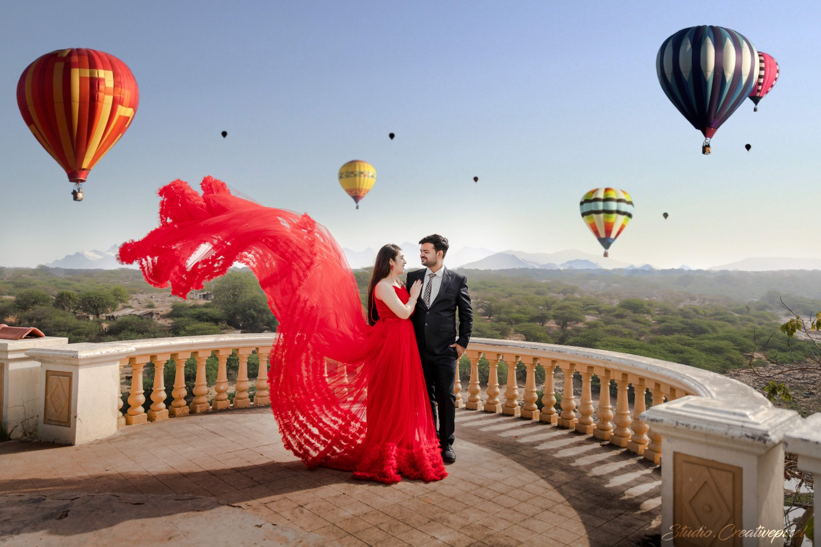 pre wedding shoot with hot air balloons in the background