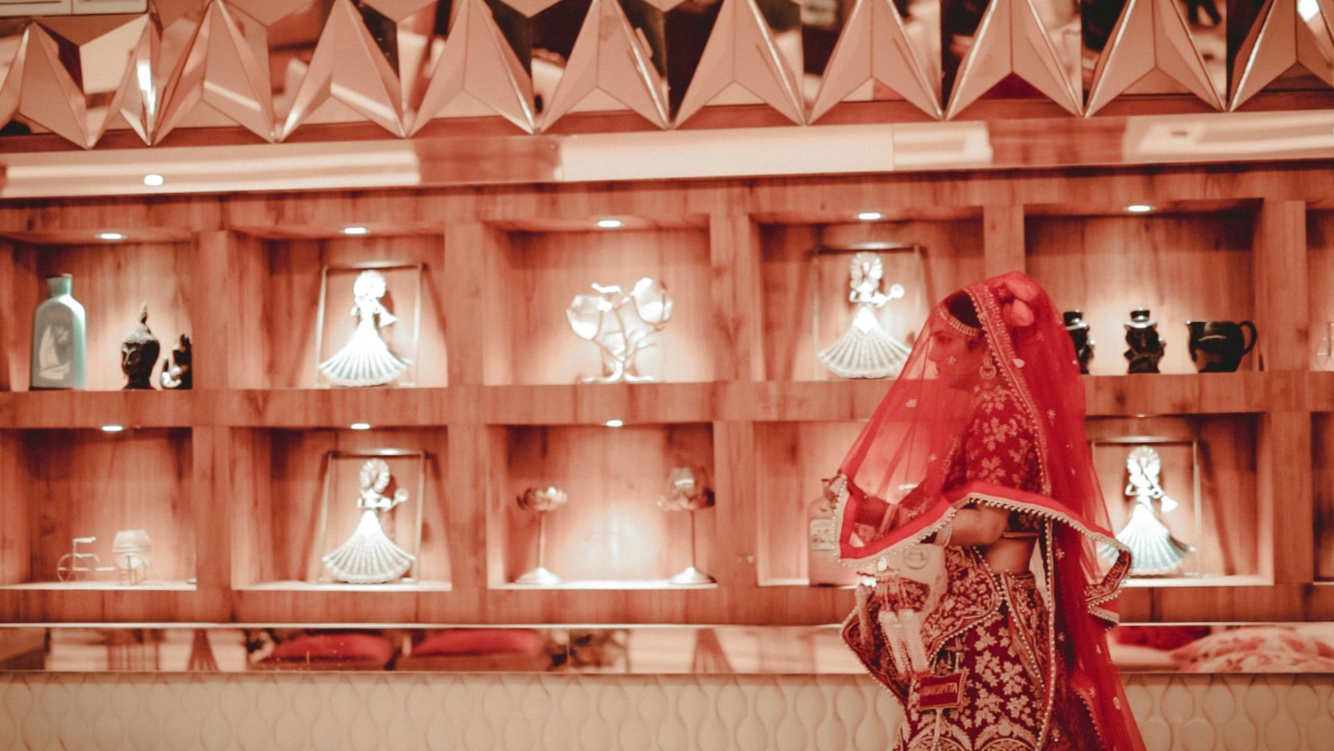 bride in red lehenga and long veil