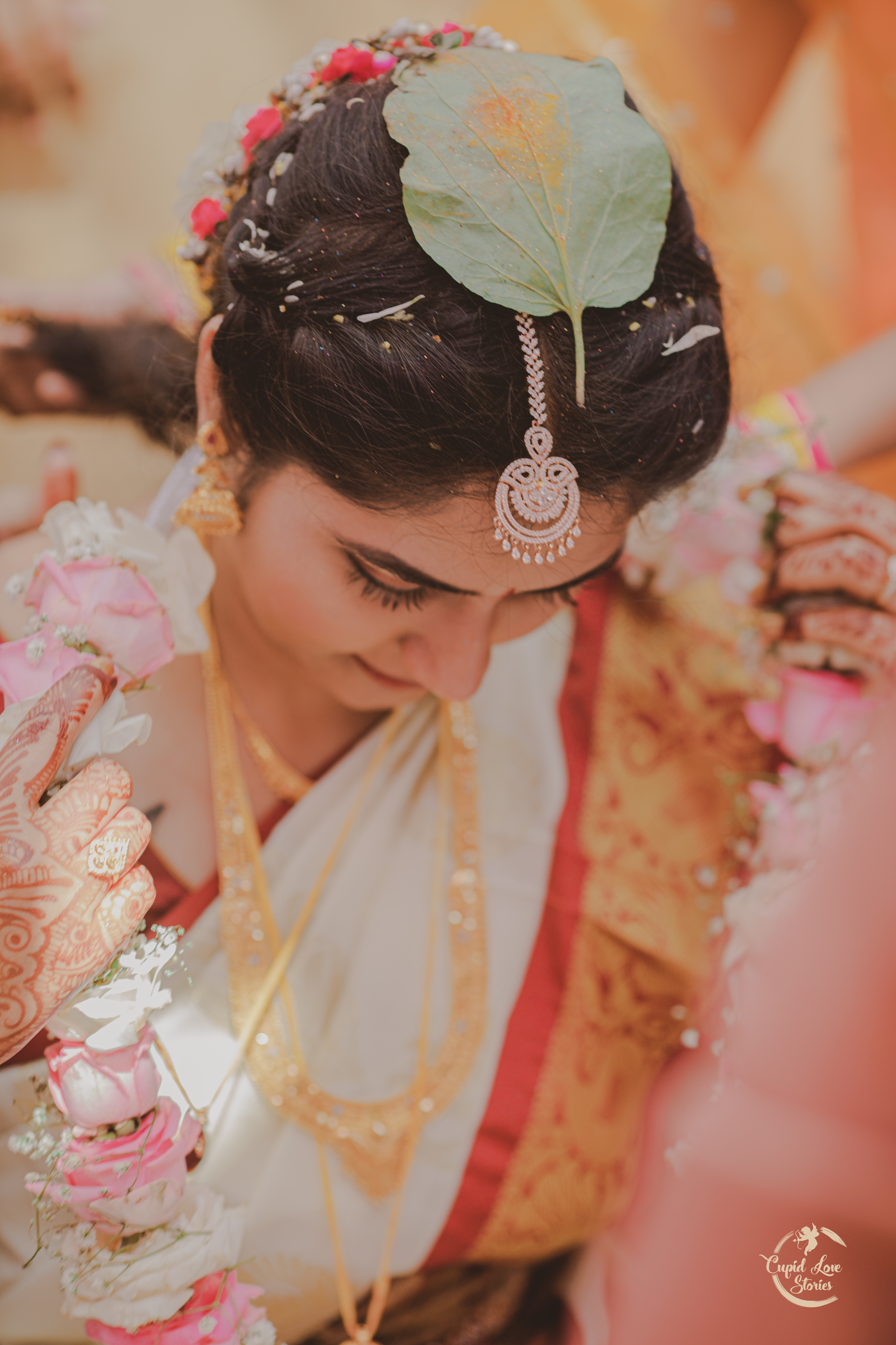 Beautiful Indian bride in white during traditional wedding rituals