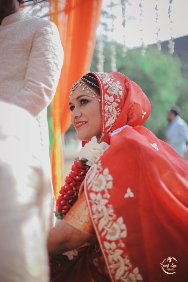 Beautiful bride in red during the wedding rituals