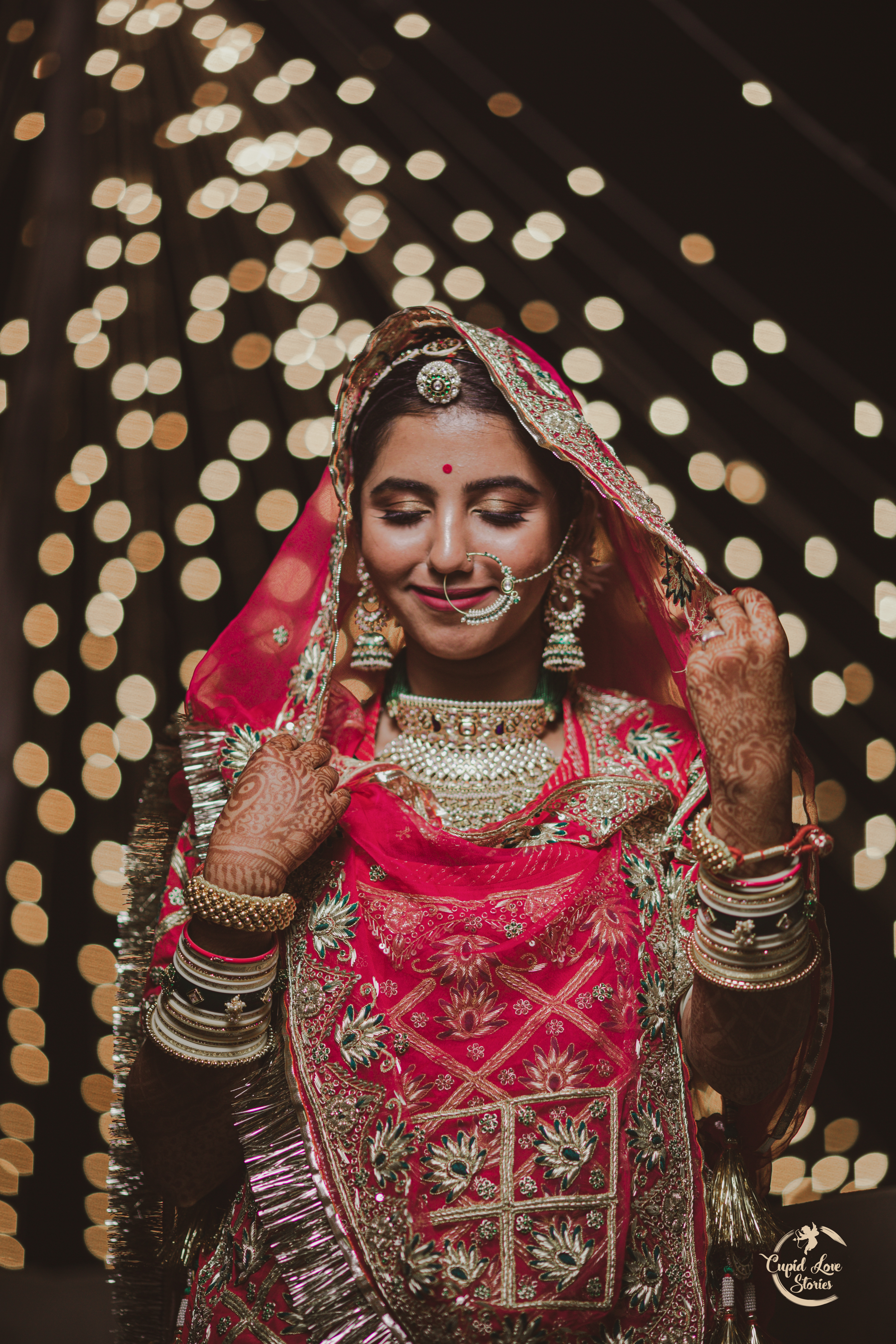 Beautiful bride in red under the lights