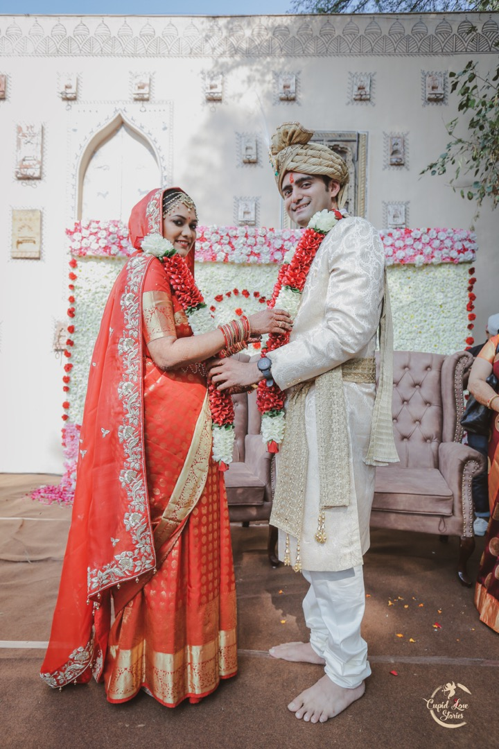 Indian Bride & Groom Posing for a Picture During Jaimala Ceremony