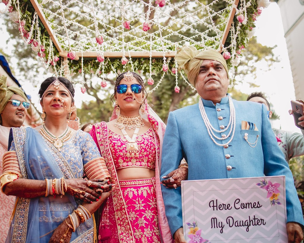 bride enters with her parents