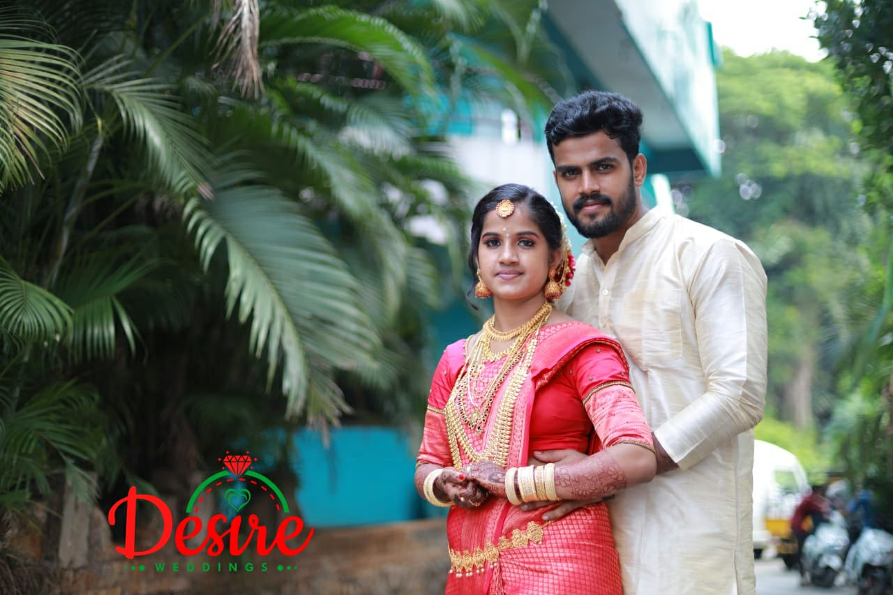 south indian couple in contrasting outfits