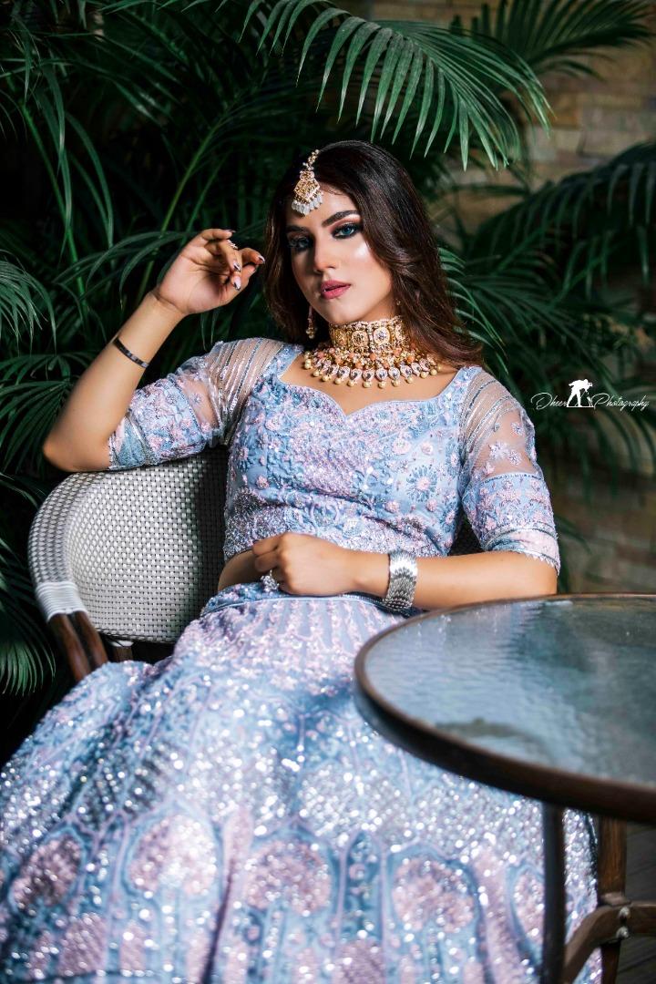 bride pose in contemporary blue lehenga
