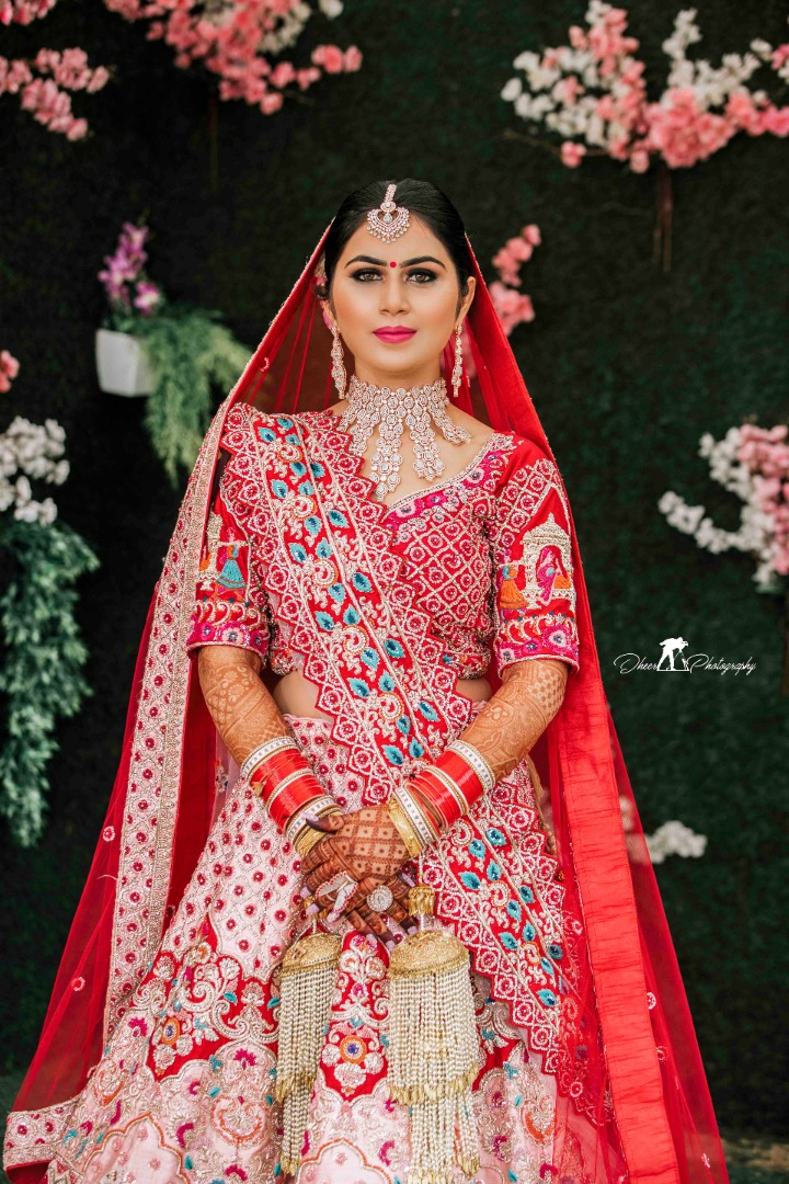 bride in a stunning red lehenga