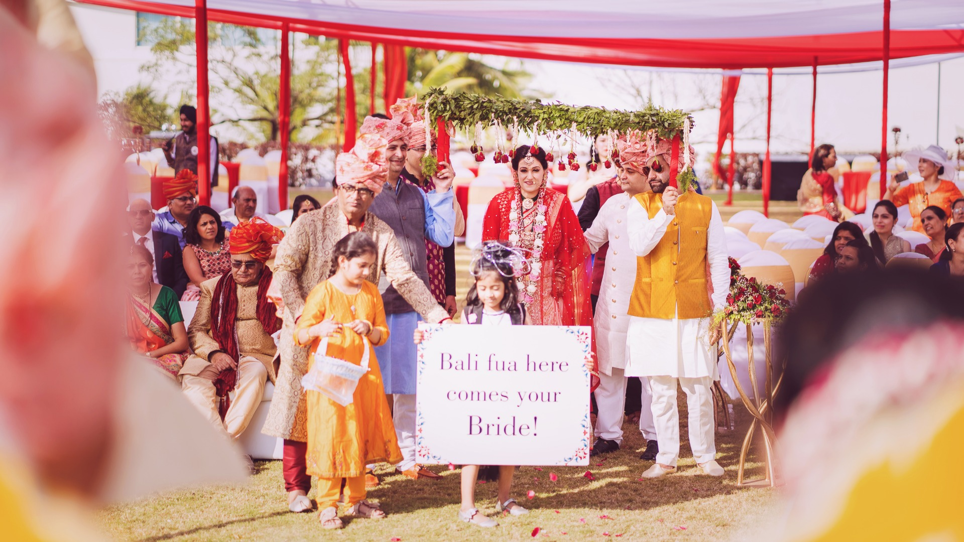 Bridal Entry in Phoolon Ki Chaadar and Funny Message Signage with Kids