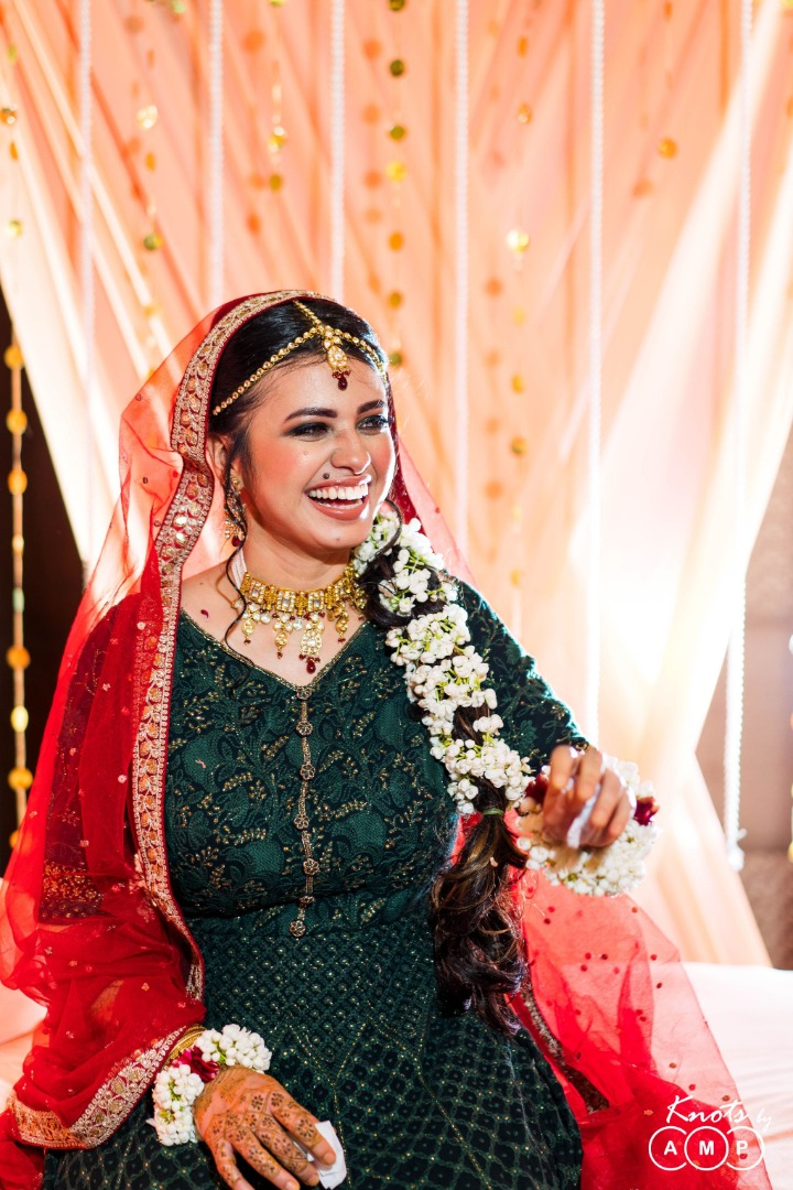 Candid Picture of Bride Laughing in Her Mehendi