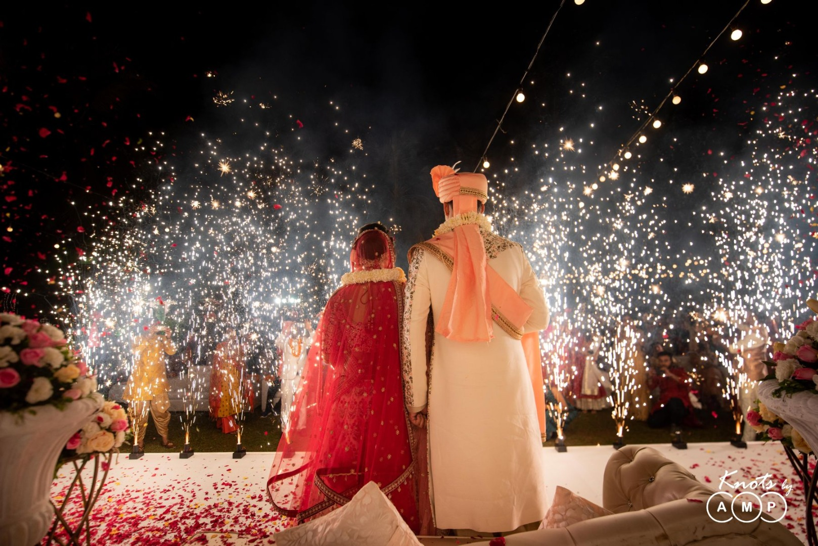 Bride Groom Post Wedding Picture on Stage with Fireworks