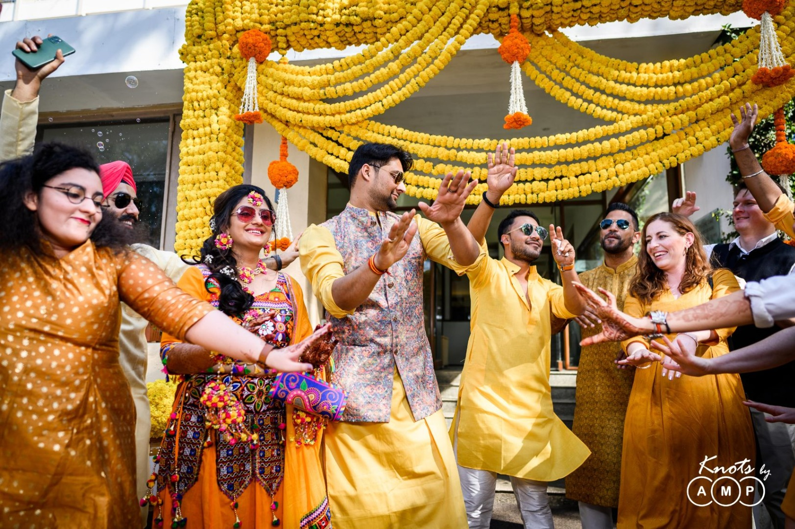 Marigold Haldi Ceremony Decor and Bride Groom & Family Dancig