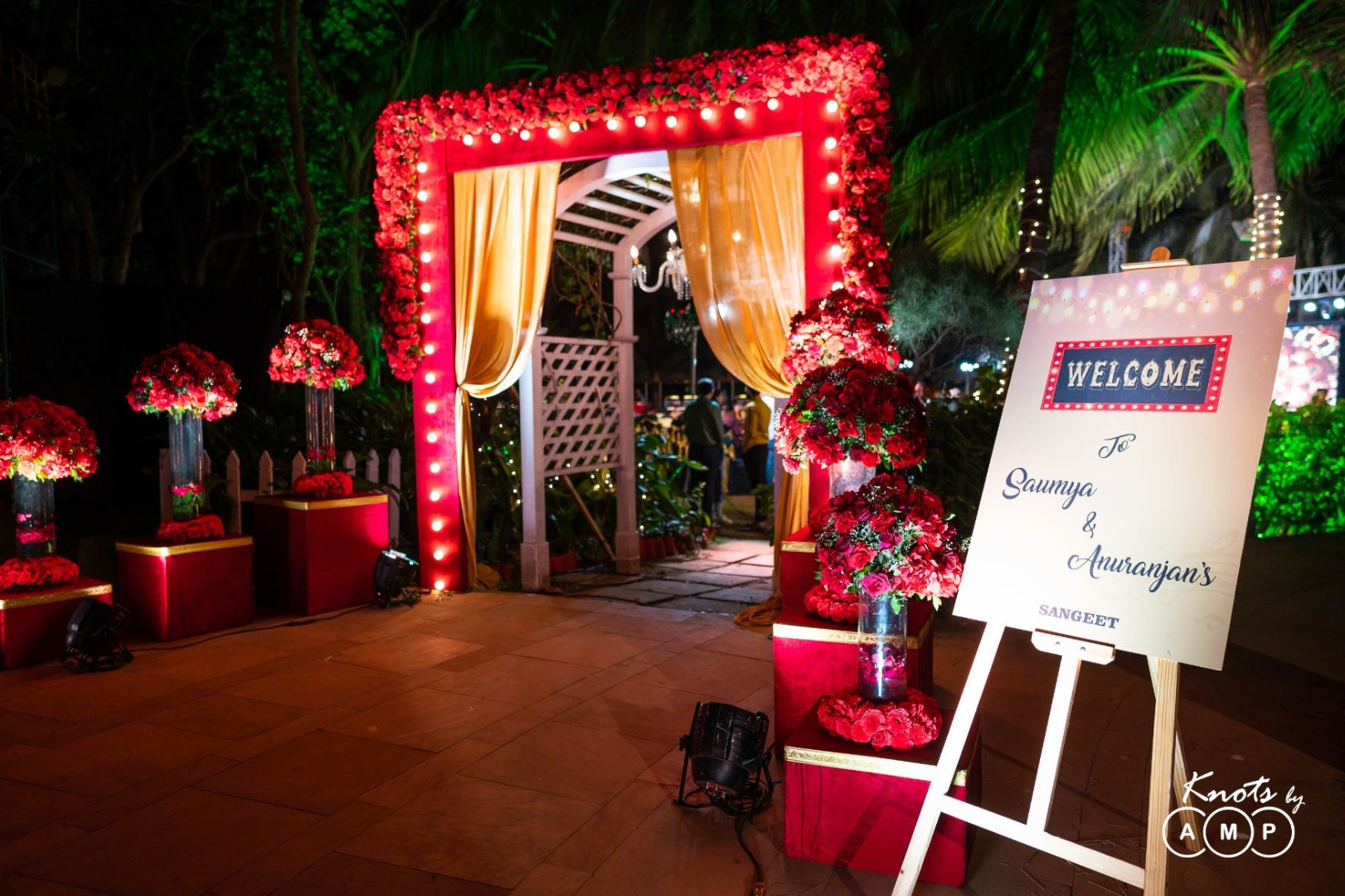 Red Theme LED Lit and Red Rose Decorated Sangeet Night Entrance with Welcome Signage