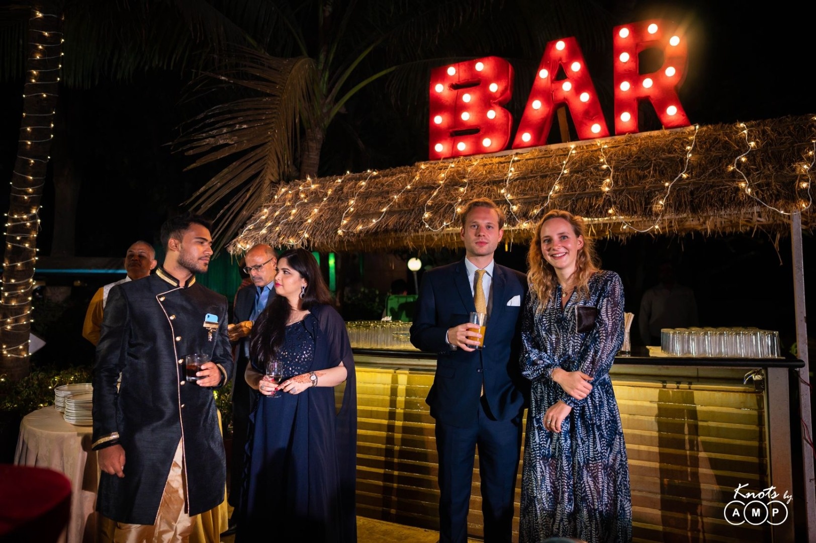 Guests at Wedding Bar with LED Lit BAR Sign